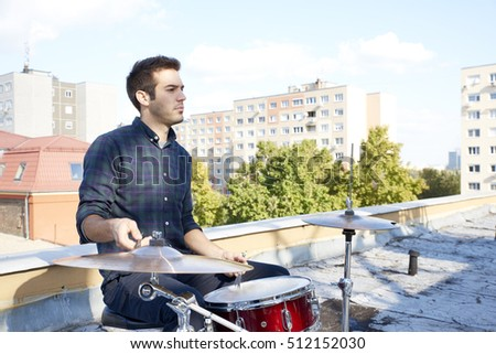 Shot of a young drummer sitting at his drum set.