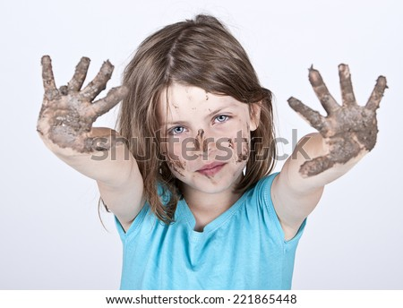 Shot of a Young Girl with Dirty Hands and Face - stock photo
