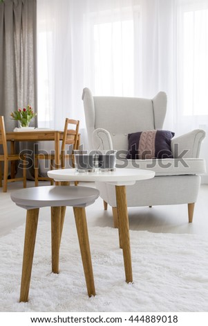 Shot of an armchair and a small table in a cozy room