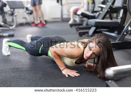 Shot of an attractive young woman working out at the gym
