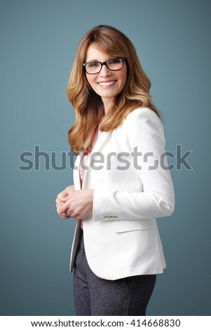 Shot of an executive professional woman standing at isolated background.