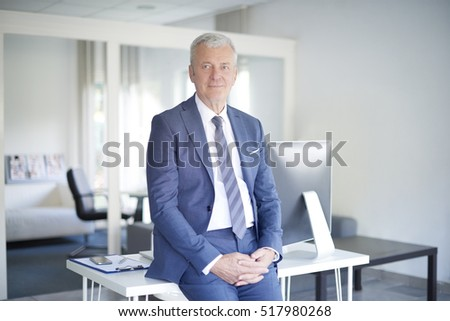 Shot of an executive senior businessman sitting at office.