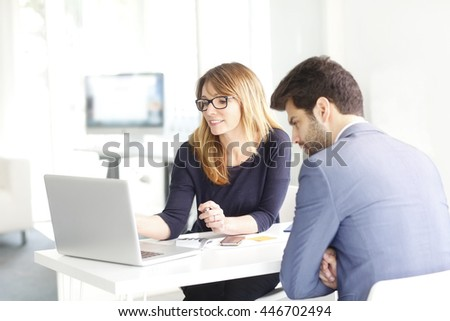 Shot of an financial advisor professional woman sitting in front of laptop and discussing with young financial assistant about business plan. - stock photo