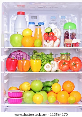 Shot of an open fridge with healthy food products - stock photo