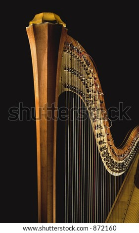 Shot of ancient harp of last century  beginning on the black background. Detail. - stock photo