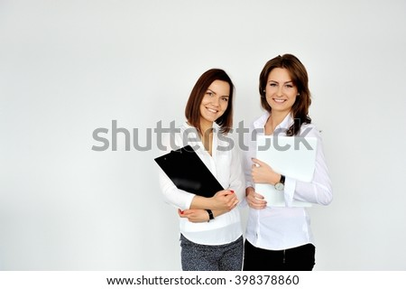 Shot of attractive two modern business women looking at the camera. - stock photo