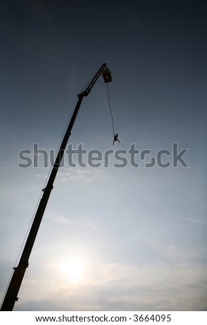 Shot of bungee jump against a sun - stock photo
