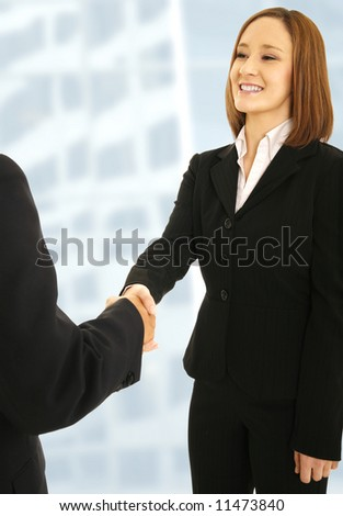 shot of business woman shaking hand with man. concept for successful woman or business deal
