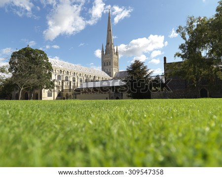 shot of cathedral on perfect english summers day with copy space in foreground  - stock photo