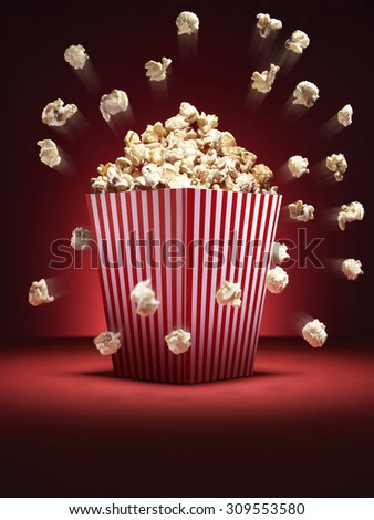 Shot of cinema style popcorn in a traditional box with pieces flying out it a comedy fashion. - stock photo