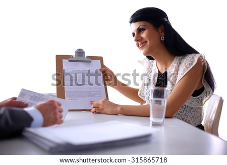 Shot of colleagues having a discussion in the office - stock photo