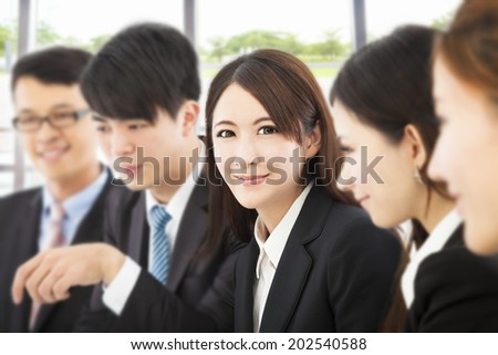 shot of focus on young business woman with colleagues - stock photo