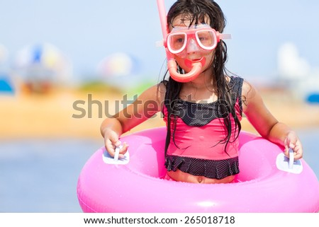 Shot of girl with snorkeling mask - stock photo
