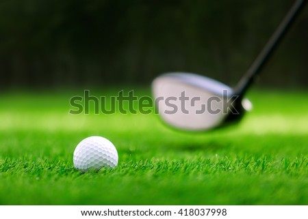 Shot of golf ball with golf club - stock photo