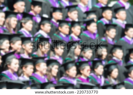 Shot of graduation caps during commencement. The image was blurred for use as a background. - stock photo