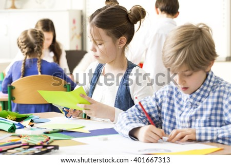 Shot of little children during art class