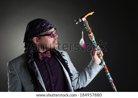 Shot of middle-aged man posing with decorated cane - stock photo