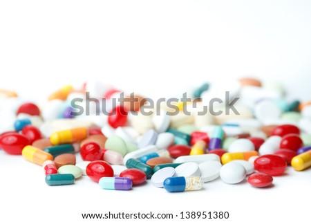 shot of multiple pills on white background - stock photo