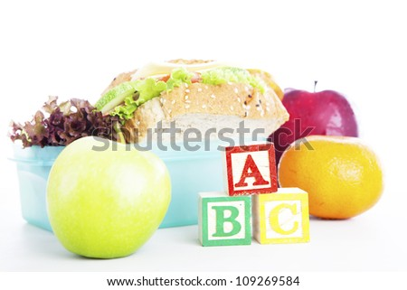 Shot of school lunch with alphabet blocks. shot in studio - stock photo