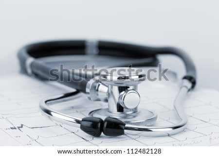 Shot of stethoscope on ECG diagram - stock photo