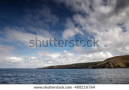 shot of the cornwall coastline taken from a boat sailing around the coast