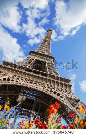 Shot of the Eiffel Tower with flowers in the foreground - stock photo