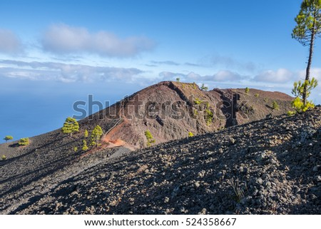 "Shot of the famous hiking path ""Ruta de los vulcanos"" , taken in the south of la Palma nearby Los Canarios. View at the rim of a volcano crater"