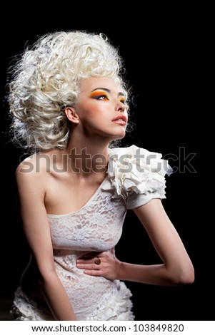 Shot of the young girl on the black background - stock photo