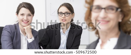 Shot of three businesswomen sitting in their office and smiling at the camera