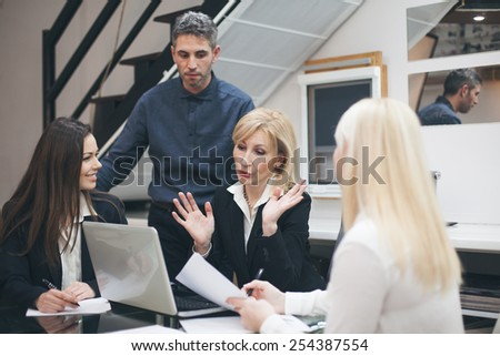 Shot of three colleagues having a meeting in the boardroom - stock photo