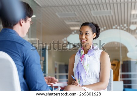 Shot of two young professionals having a discussion at a desk - stock photo
