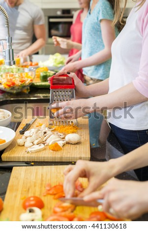 Shot of unrecognisable people preparing food. - stock photo