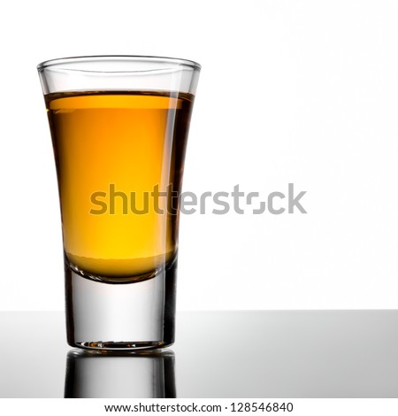 Shot of whiskey on a white background - stock photo