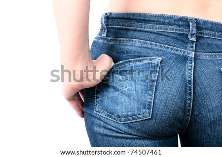 Shot of young woman behind in worn out jeans - stock photo