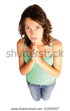 Shot of young woman praying, isolated on white background - stock photo