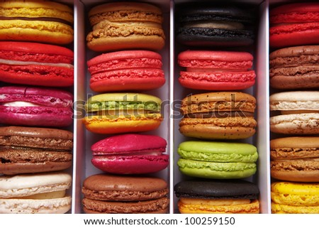 shot taken from above of a box full of macaron or French macaroon, colourful meringue-based almond treats