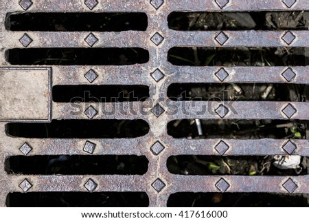 Shot to a metal sewer cover from the top with patterns and details - stock photo