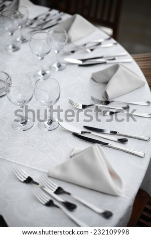 Shot with a dinner table in a restaurant. - stock photo