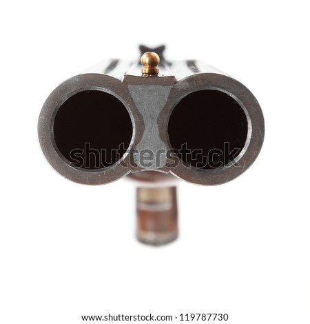 Shotgun aimed at you. Gun control concept. Close up with shallow DOF. - stock photo