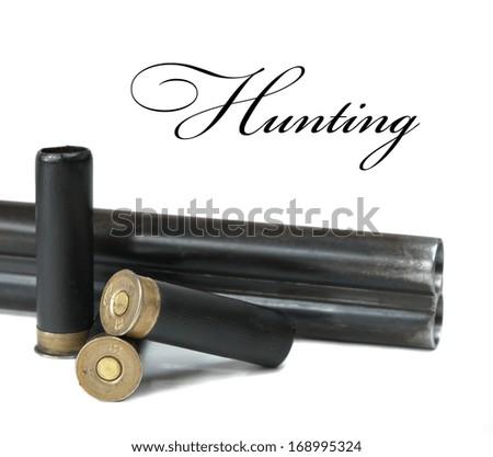 shotgun barrels and three cartridges - stock photo