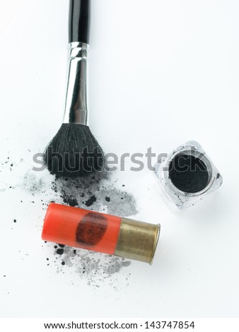 shotgun bullet cartounche with a fingerprint revealed by a brush and printing dust next to a small dust container and a brush, against a white background - stock photo