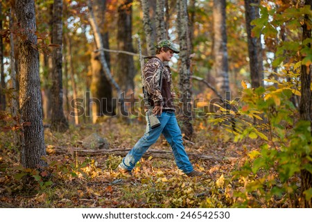 shotgun hunting for deer in a fall forest in geogia - stock photo