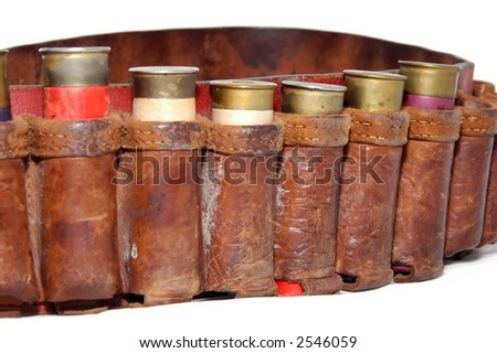 Shotgun shells in a belt - stock photo
