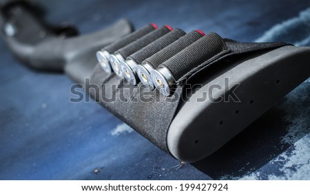 Shotgun waiting to be picked up and fired. - stock photo
