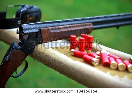 Shotgun with cartridges - stock photo