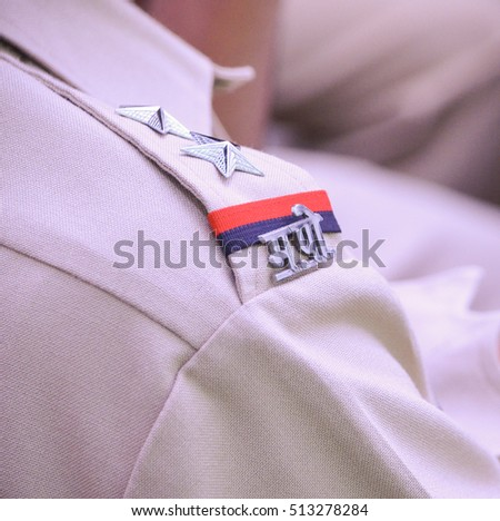 Shoulder Badges on the uniform of a Mumbai police officer.Image taken during an awareness event at a police station in Mumbai situated in the state of Maharashtra,India.Image date:22nd May 2015