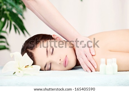 Shoulder massage in spa center
