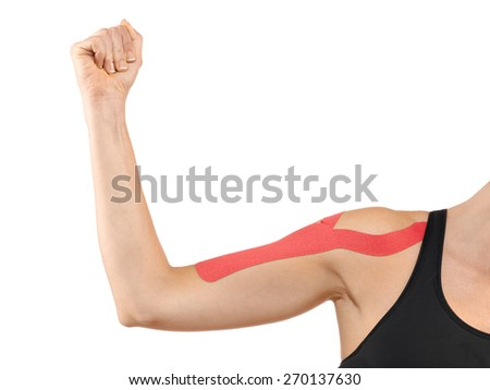 Shoulder treated with tex tape therapy. - stock photo
