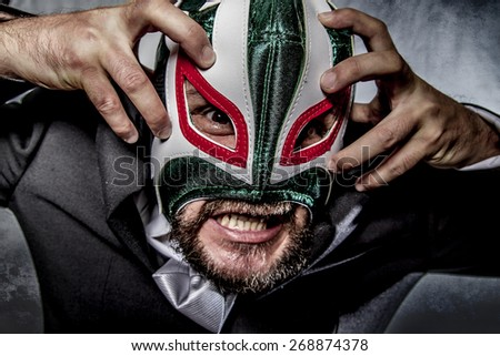 Shouting, angry businessman  with Mexican wrestler mask - stock photo