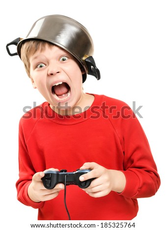Shouting boy with a pan on the head and the game pad in hands is isolated on a white background. Very emotional.